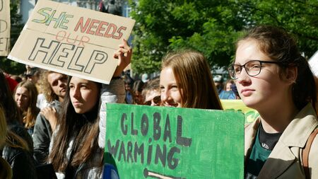 BRNO, CZECH REPUBLIC, SEPTEMBER 20, 2019: Friday for future, demonstration against climate change, banner sign she needs our help. Global warming, crowd young people students ecology Archivio Fotografico - 131611721