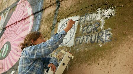 OLOMOUC, CZECH REPUBLIC, SEPTEMBER 22, 2019: Friday for future wall painting Marie Zatloukalova organizer in Olomouc, action Extinction Rebellion demonstration