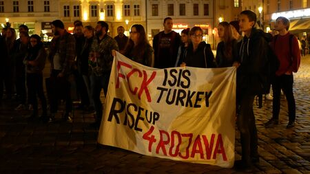 PRAGUE, CZECH REPUBLIC, OCTOBER 17, 2019: Kurdish people demonstration against Turkey and President Recep Tayyip Erdogan, banner flag sign Fck Isis Turkey rise up 4 Rojava, activists Archivio Fotografico - 132990157
