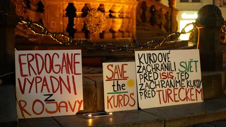 PRAGUE, CZECH REPUBLIC, OCTOBER 17, 2019: Demonstration against Turkey banners flag sign Erdogan get out of Rojava, save the Kurds, Kurds saved the world from the Isis Islamic State Archivio Fotografico - 132990156
