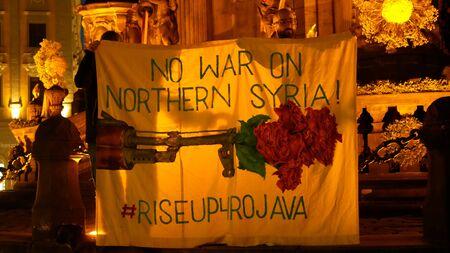 PRAGUE, CZECH REPUBLIC, OCTOBER 17, 2019: Kurdish people demonstration against Turkey and President Recep Tayyip Erdogan, banner flag sign No war on Northern Syria rise up 4 Rojava, activists Archivio Fotografico - 132990158