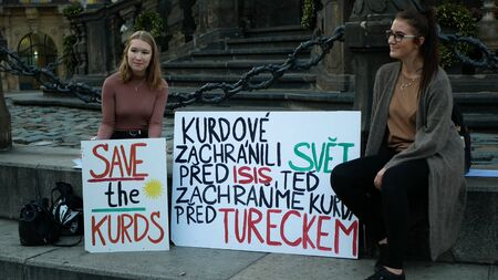 PRAGUE, CZECH REPUBLIC, OCTOBER 17, 2019: Demonstration people against Turkey banners flag sign save the Kurds, Petra Cermakova and Anna Slesingerova young girls students Archivio Fotografico - 132990277