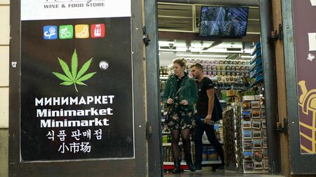PRAGUE, CZECH REPUBLIC, SEPTEMBER 9, 2019: Shop hemp cannabis medical, also sells seeds products, addicted people use drugs, storefront display shop with cannabis symbols leaf, people Archivio Fotografico - 132990397