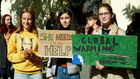 BRNO, CZECH REPUBLIC, SEPTEMBER 20, 2019: Friday for future, demonstration against climate change, banner sign she needs our help. Global warming, crowd young people students ecology Archivio Fotografico - 132990399