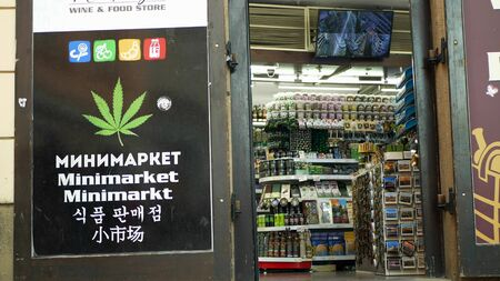 PRAGUE, CZECH REPUBLIC, SEPTEMBER 9, 2019: Shop hemp cannabis medical, also sells seeds products, addicted people use drugs, storefront display shop with cannabis symbols leaf, people Archivio Fotografico - 132990593
