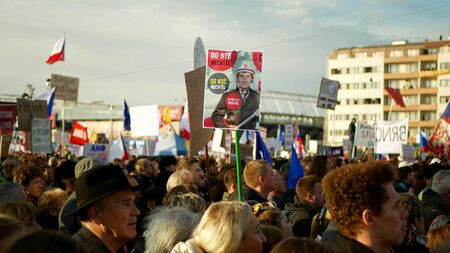 PRAGUE, CZECH REPUBLIC, NOVEMBER 16, 2019: Demonstration of people crowd, banner Andrej Babis did not want to the STB and the Communist Party, throng of activists Letna Prague, flags