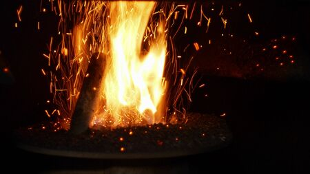 Fire burn pellets with spruce sawdust into delivery strew bio wooden pallets industrial modern boiler, sparks fly out flames fire detail closeup, biofuels made compressed matter organic biomass, fuel