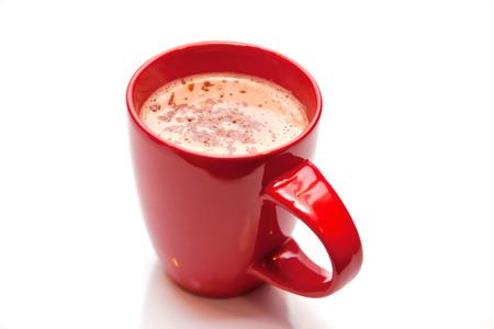 白で隔離赤いカップのホット チョコレート 写真素材