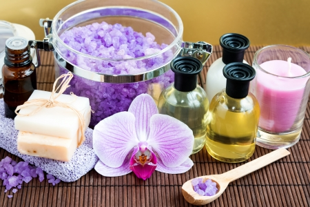 Spa composition with salt, soap, bottles and pink orchid Stock Photo