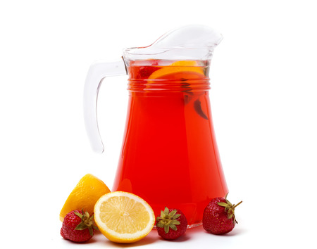 Fresh homemade strawberry lemonade in a jug isolated on white background photo