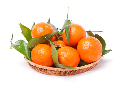 Fresh juicy tangerines with green leaves isolated on white background