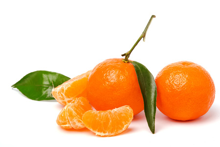 Fresh juicy tangerines with green leaves isolated on white background photo