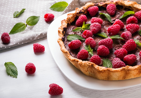 custard slice: Delicious chocolate tart with raspberry on the white plate Stock Photo