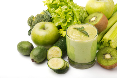 Healthy green smoothie, vegetables and fruits isolated on white background photo