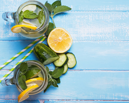 cucumbers: Lemon and cucumber detox water in glass jars Stock Photo