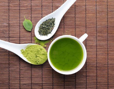 green powder: Green tea on the brown mat top view