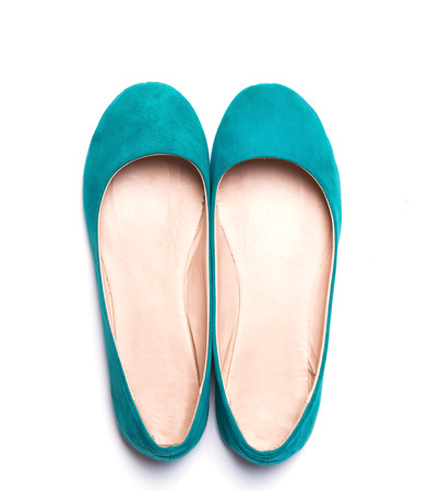 flat foot: Flat woman shoes of bright turquoise color isolated on white background