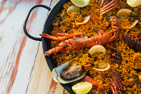 marisco: Seafood paella on the wooden table close-up Stock Photo