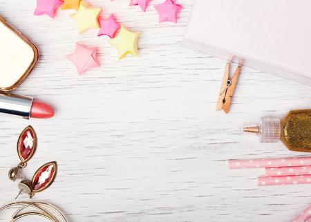 femenine: Cute small femenine stuff on the white table, top view
