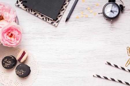 Stylish desktop with cute femenine essentials, top view