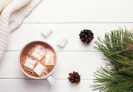 Hot cocoa with marshmallows on white table, top view