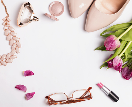 Stylish feminine acessories and pink tulips 스톡 콘텐츠