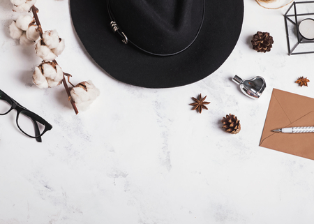 Womans hat, glasses, cotton branch and other small objects, top view