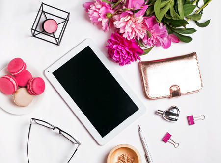 Stylish feminine accessories, peonies and tablet with blank screen on the white background, top view Stock Photo