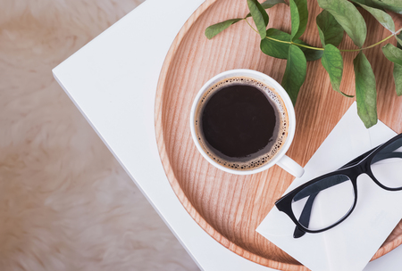 Coffee and glasses on the small coffee table, top view