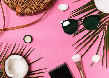 Summer flat lay. Feminine vacation accessories on the pink background, top view Stock Photo