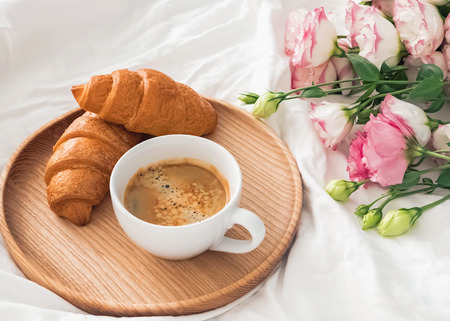 Breakfast in bed with coffee and croissants Stock Photo