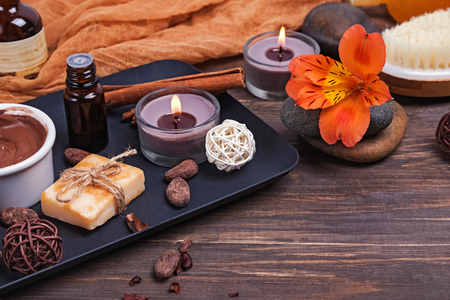 Chocolate spa set on the wooden background, close-up.