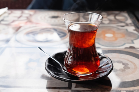 A glass of traditional turkish tea on the table 写真素材