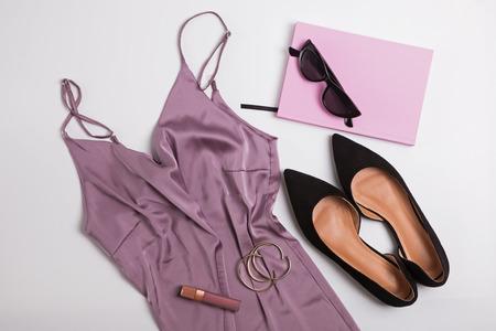 Stylish feminine accessories isolated on white background. Stock Photo