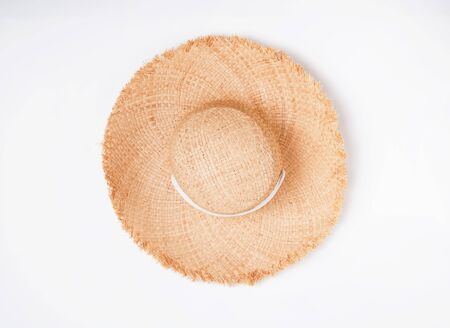 Feminine straw hat with big fields isolated on thite background, top view