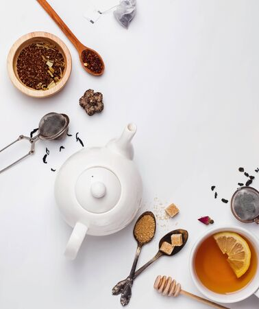 Creative composition witn variety of tea, sugar, lemon and other accessories for making tea