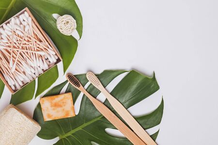 Zero waste bathroom essentials, top voew. Bamboo tooth brushes, cotton swabs and other Stock Photo