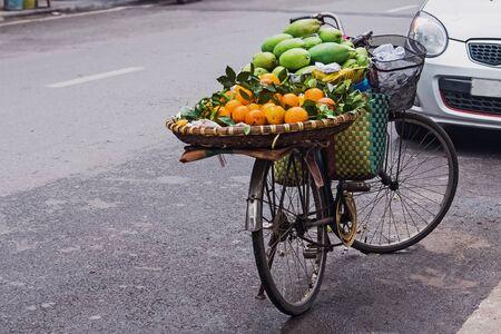 Vendor of fruits bicycle on the street of Hanoi, Vietnam.