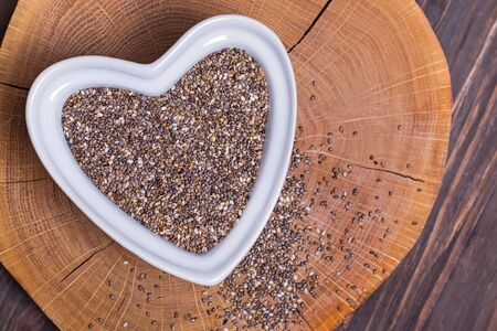 Chia seeds in a white heart shaped bowl