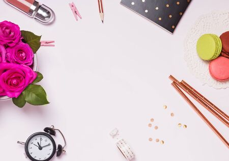 Flat lay composition with flowers, macarons and stationery on white background