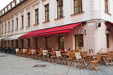 Empty street cafe in small European town Stock fotó