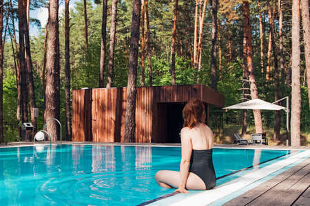 Woman relaxing near the swimming pool