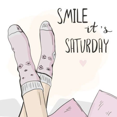 Womans legs in cozy socks and hand lettering Smile Its Saturday.