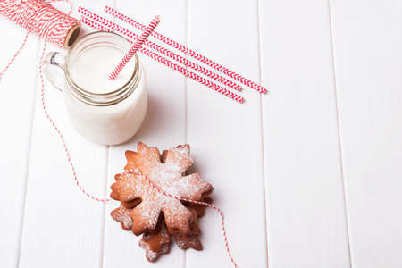 Christmas gingerbread cookies and milk in a jar