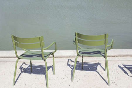 Two empty green metal chairs in Tuileries garden