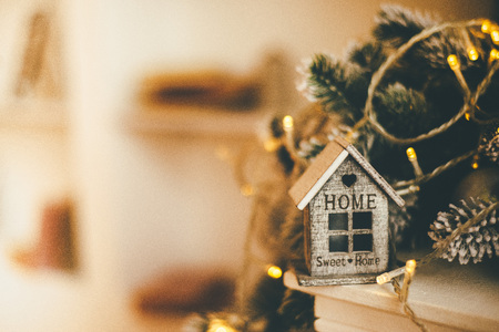 Athmospheric Christmas-related house decorations - lights and wooden home 写真素材