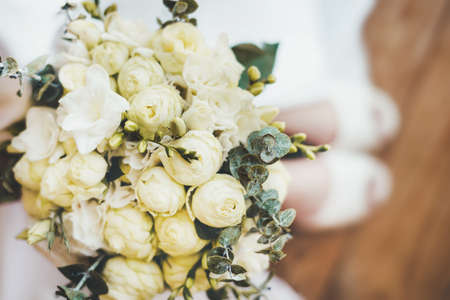 Close-up with a beautiful delicate bouquet with peony-shaped roses