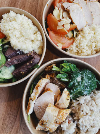 Healthy bowls of healthy food in boxes, with meats, vegetables and cereals. Balanced tasty food for losing weight or maintaining the required weight. High quality photo