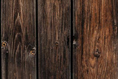 Three wide wooden planks. Textured background dark brown macro Standard-Bild