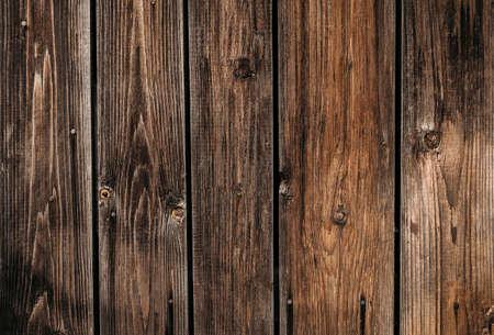 Dark brown fence textured wooden background close up. Standard-Bild